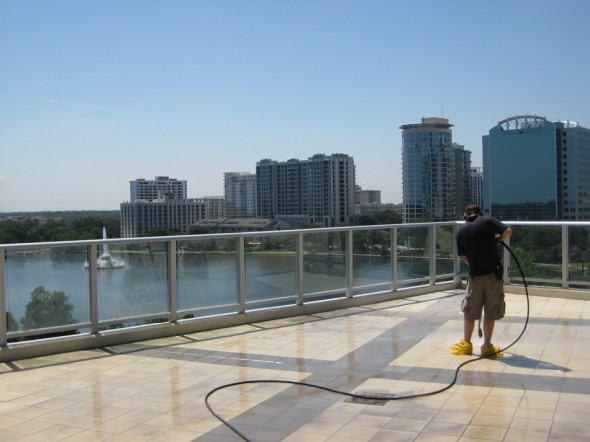 """Green"" Pressure washing, 7th floor patio @ The Vue"